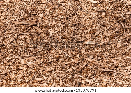 Detailed view at a pile of wood pieces after shredding trees. - stock photo