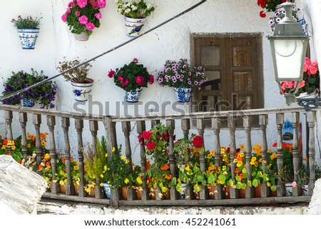 Detailed view house with balcony and plantpots in Capileira, Granada, Spain - stock photo