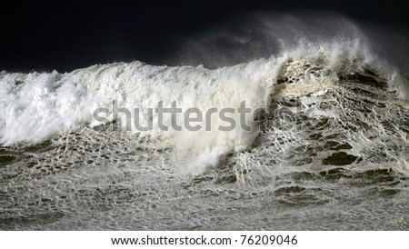 Detailed view of a beautiful big crashing wave in a stormy day - stock photo
