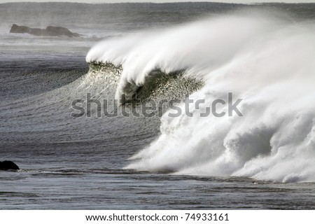 Detailed view of a beautiful big white crashing wave in a stormy day - stock photo
