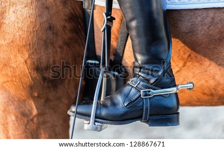 detailed view of a boot rider with spurs wheel - stock photo