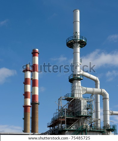 Detailed view of a distillation tower of a petrol refinery. - stock photo
