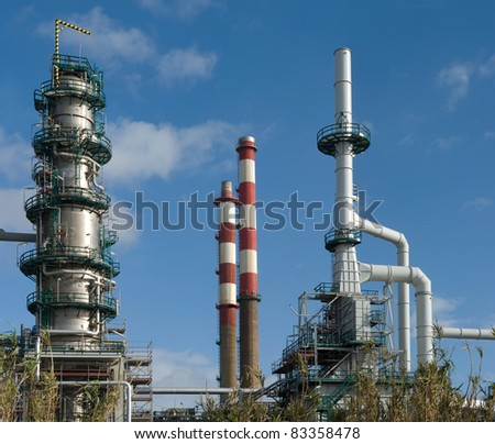 Detailed view of a distillation tower of a petrol refinery.Square frame. - stock photo