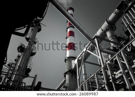 Detailed view of a refinery chimney exhausting smoke. - stock photo
