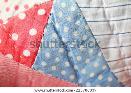 Detailed view of antique quilt - stock photo