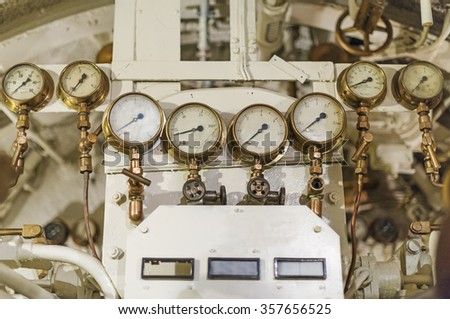 Detailed view of many manometers inside of submarine. - stock photo