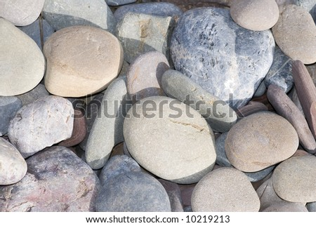 Detailed view of pebbles, suitable for background or texture - stock photo