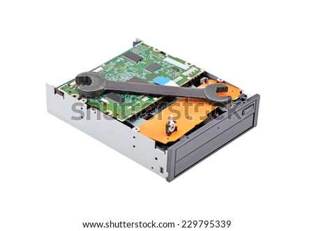 Detailed view of the inside of dvd disk drive and wrench - stock photo