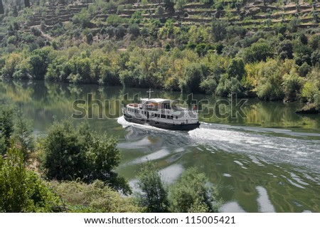 Detailed view of the picturesque world famous Douro River with a tourist sightseeing boat.(UNESCO World Heritage Site) - stock photo