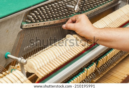 Detailed view of Upright Piano during a tuning - stock photo