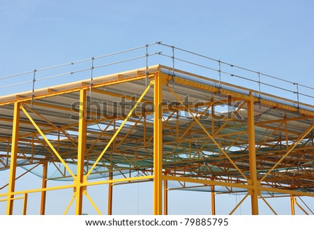 Detailed view of yellow steel frame construction - stock photo