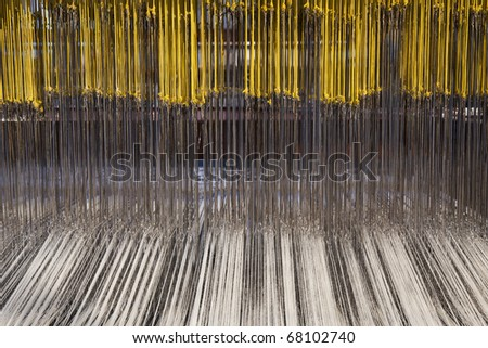 Detailed view on a damask weaving machine - stock photo