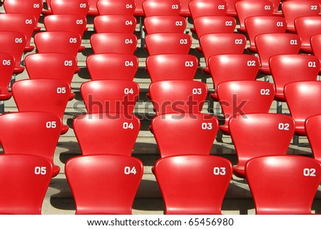 Detailed view on tribune seats in a football - olympic atletic stadium - stock photo