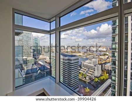 detailed view through floor to ceiling double glazed window - stock photo