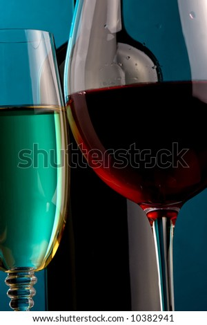 details a glass of white wine a glass of red wine and a bottle