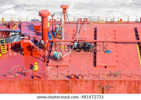 Details and Ropes on Red Industrial Ship