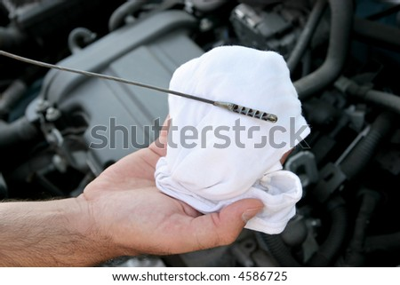 Details checking engine oil dipstick in car - stock photo