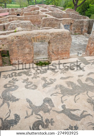 Details in the old town of Ostia, Rome, Italy. Ruins of an ancient roman thermal establishment with mosaic on the floor, heritage of early italian history, now travel destination for tourists. - stock photo