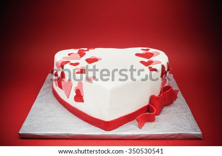 Details of a cake in shape of heart.  - stock photo