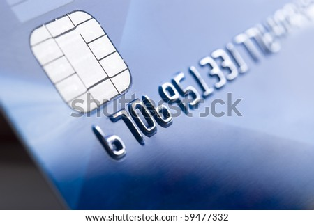 Details of a credit card with chip and numbers, shallow DOF - stock photo