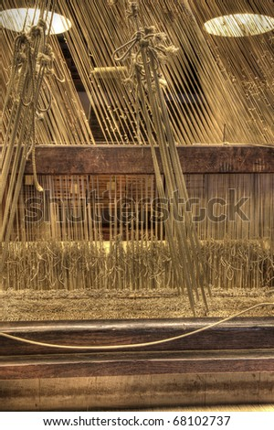 Details of a damask weaving machine - stock photo