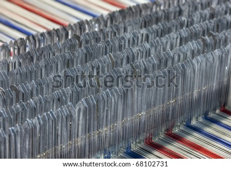 Details of a dobby weaving machine, which is capable of selectively raising a number of warp threads in a fixed pattern - stock photo