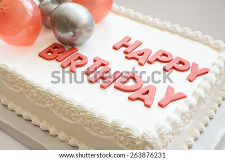 Details of a happy birthday cake, on white background.  - stock photo