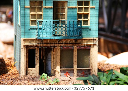 Details of a houses near miniature railroad, set in a public park - stock photo