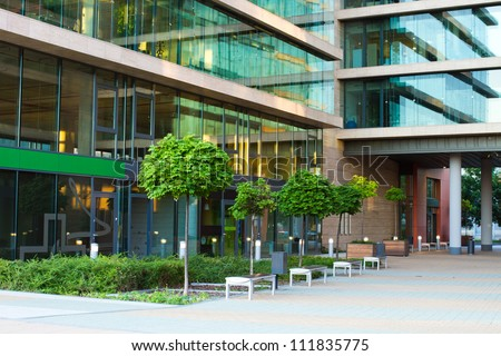details of a modern office building with many windows - stock photo