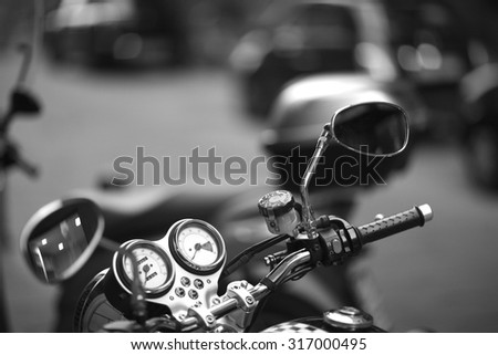 Details of a motorbike; side windows, speedometer, tachometer  - stock photo