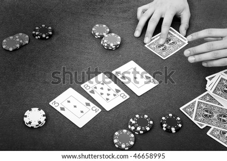 Details of a poker table during a game - stock photo