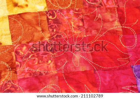 Details of a quilted blanket - stock photo