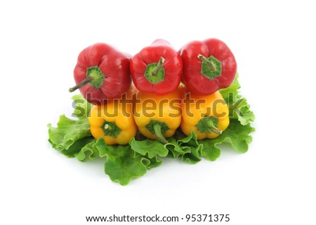 details of a  red and yellow  bell pepper isolated on white