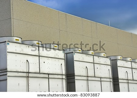 Details of a roof in a factory filled with cooling towers - stock photo