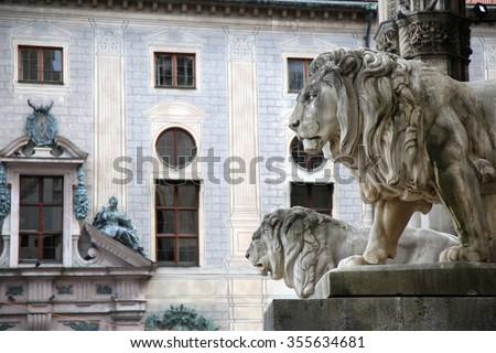 details of a stone lion sculpture at the Odeonsplatz - Feldherrnhalle in Munich Germany - stock photo