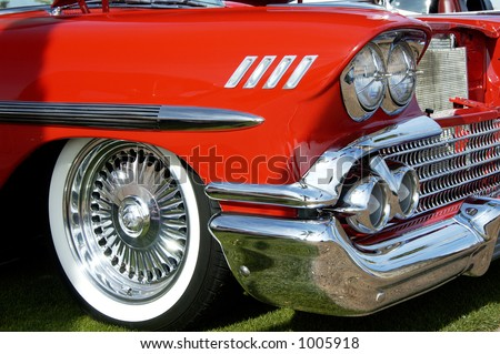 Details of a vintage red chevrolet on display at a car show. - stock photo