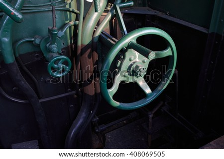 Details of a vintage steam train driving cabin. - stock photo