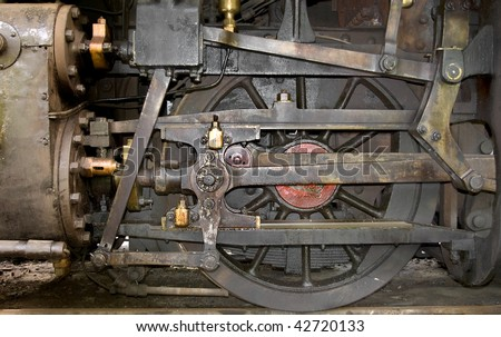 Details of a vintage steam train propulsion system. - stock photo