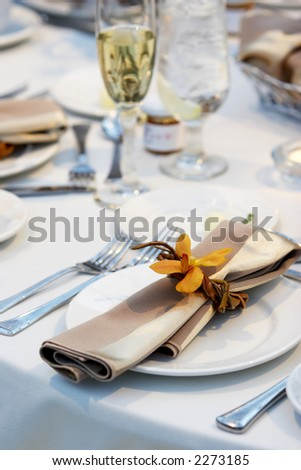 Details of a wedding table set for fine dining with an orchid - stock photo