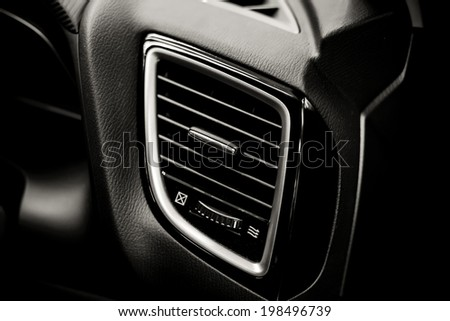 Details of air conditioning (car ventilation system) in modern car , black and white - stock photo