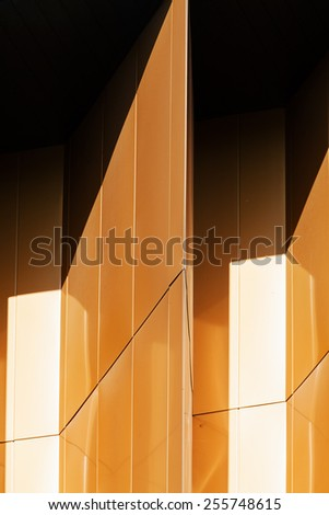 details of aluminum facade with colorful red and orange panels  - stock photo