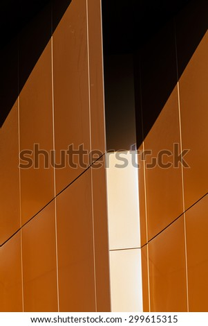 details of aluminum facade with colorful red and orange panels on large shopping mall - stock photo