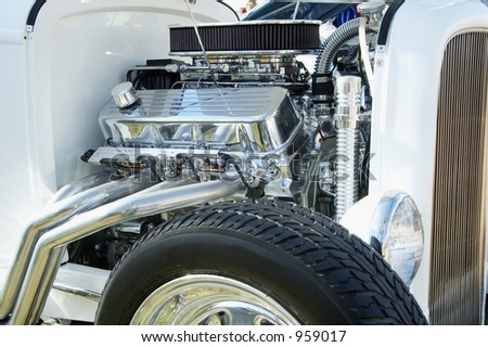 Details of an engine in a customized vehicle. - stock photo