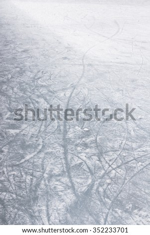 Details of an ice skating rink, with marks and scratches of skate blades. - stock photo