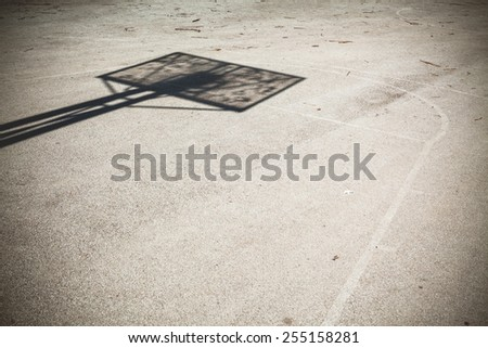 Details of an old basketball playground, outdoor, asphalt and shadow of a basket construction. . - stock photo