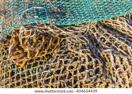 Details of an old fishing net fishing net in the port - stock photo