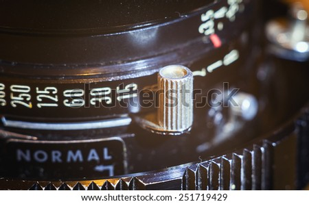 Details of an old lens for large format cameras. Shutter speed adjustments.  - stock photo