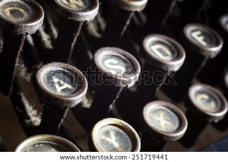 Details of an old retro typewriter, vintage style, dusty surfaces.  - stock photo