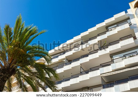Details of apartments building with balconies. - stock photo