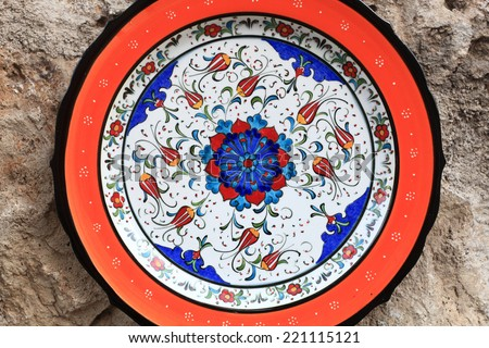 Details of arabic plate on a wall background - stock photo